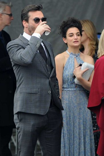 on Hamm gets a kiss from Jenny Slate and sips his coffee while standing in line! LA