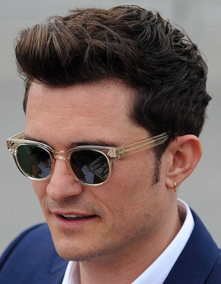 941bd3d94519 Orlando Bloom fashioned an earring in his left ear wearing some stylish  round framed Oliver Peoples sunglasses in Santa Monica, Los Angeles.