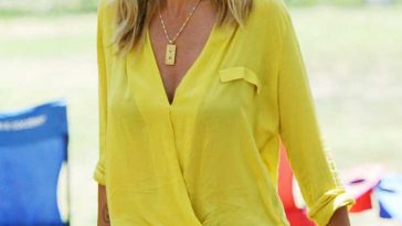 Heidi Klum wore a bright yellow shirt with her sleeves rolled up out and about in Brentwood © Atlantic Images