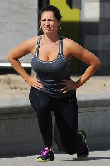 Kelly Brook fashioned a revealing workout top on Santa Monica beach © Atlantic Images