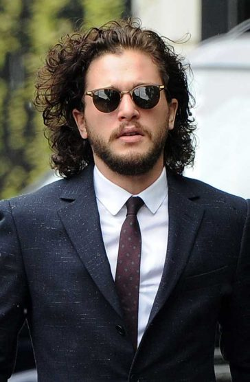 Is that Jon Snow? Kit Harington looked stylish in a subtle polkadot tie, suit, short and sunglasses © Atlantic Images