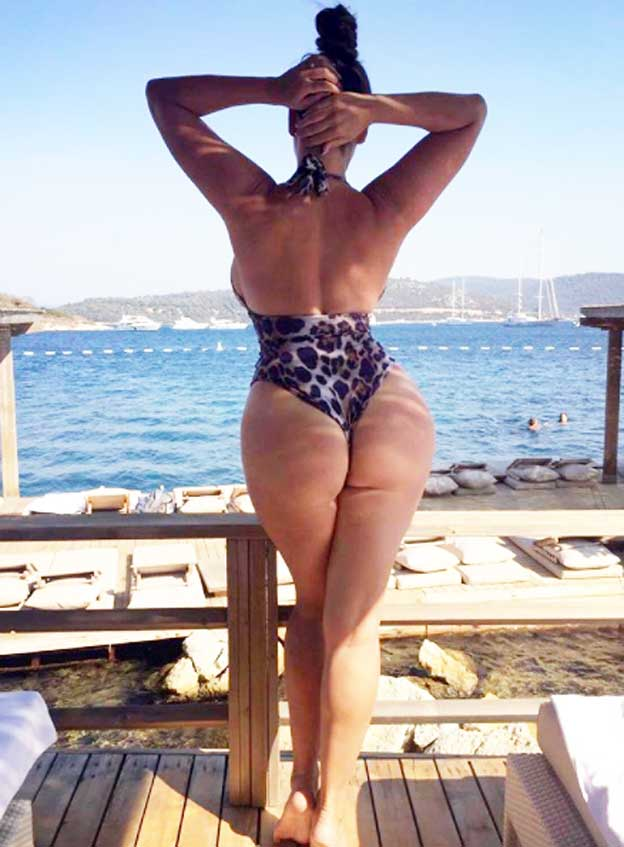 Kelly Brook shared a cheeky picture of bum in a patterned swimsuit - Photo  courtesy of  iamkb   Instagram 7af45aec5