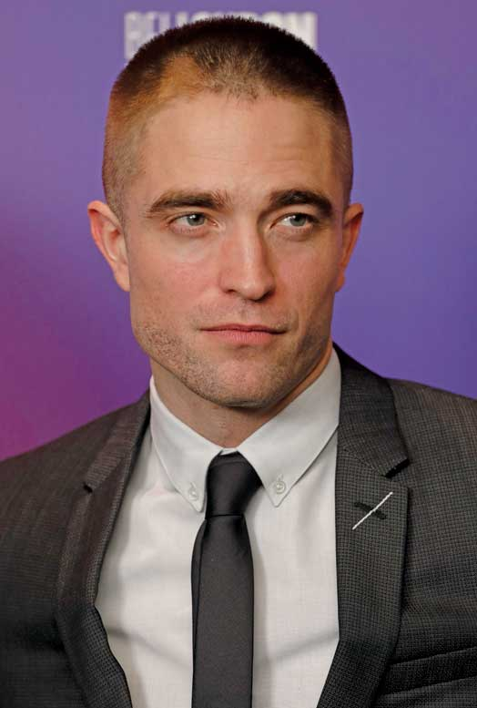 Robert Pattinson sparked comments on Social Media with his new short hair skinhead haircut at the