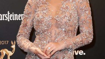 """7e02584fe7d Rita Ora In """"Nude Illusion"""" Zuhair Murad Feathered Gown At The Star-Studded  BAMBI Awards 👗👀"""