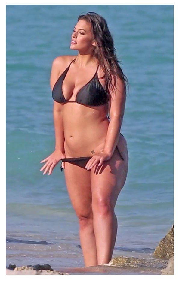 2d65279641 Ashley Graham lowers her bikini bottoms revealing hip tattoo as she poses  for a photo shoot