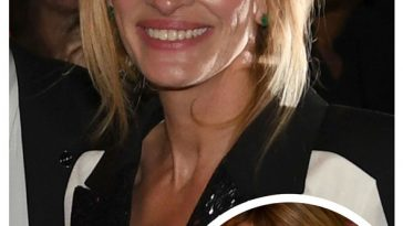 Julia Roberts flashes a smile and her beige bra at the Toronto Film Festival! © Atlantic Images